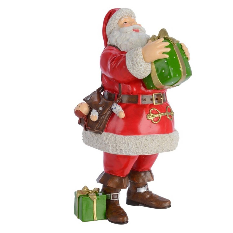Kerstman beeld met cadeautje 23 cm